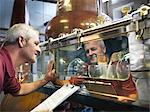 Worker checking whisky in distillery Stock Photo - Premium Royalty-Free, Artist: Photocuisine, Code: 649-04248748