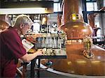 Worker checking whisky in distillery Stock Photo - Premium Royalty-Freenull, Code: 649-04248749
