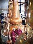 Workers checking stills in distillery Stock Photo - Premium Royalty-Freenull, Code: 649-04248754