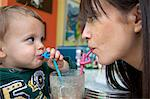 Mother and baby son using curly straws Stock Photo - Premium Royalty-Free, Artist: AWL Images, Code: 649-04248856