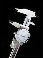 Dial calipers Stock Photo - Premium Royalty-Freenull, Code: 679-04249869