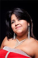 happy large latin woman, well dressed , isolated on  black studio shot Stock Photo - Royalty-Freenull, Code: 400-04256577