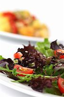 Mixed greens with cherry tomatoes sprinkled with sesame seeds. Shallow DOF Stock Photo - Royalty-Freenull, Code: 400-04262121