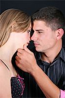 Young couple in love, faces close to one another Stock Photo - Royalty-Freenull, Code: 400-04264141