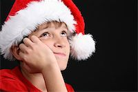 Young boy wearing a red shirt and christmas hat Stock Photo - Royalty-Free, Artist: vanell, Code: 400-04265196