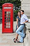Romantic man and woman couple next to traditional red telephone box in Westminster, London, England, Great Britain Stock Photo - Royalty-Free, Artist: darrenbaker                   , Code: 400-04266683