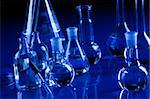 Laboratory Glassware in blue table in laboratory Stock Photo - Royalty-Free, Artist: FikMik                        , Code: 400-04273425