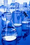 Laboratory Glassware in blue table in laboratory Stock Photo - Royalty-Free, Artist: FikMik                        , Code: 400-04273449