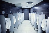 group of white porcelain urinals in public toilets photo Stock Photo - Royalty-Freenull, Code: 400-04275019