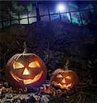 Halloween pumpkins on rocks in a forest at night Stock Photo - Royalty-Free, Artist: Sandralise                    , Code: 400-04275424