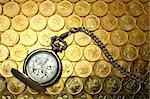 Pocket watch on money background, Hong Kong $0.5 coins Stock Photo - Royalty-Free, Artist: leungchopan                   , Code: 400-04278672