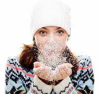 Beautiful woman blowing snow.  isolated over white Stock Photo - Royalty-Freenull, Code: 400-04289904
