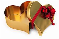 Open gold gift in the form of heart. isolated on white. with clipping path. Stock Photo - Royalty-Freenull, Code: 400-04291740