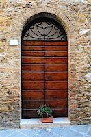 Close-up Image Of Wooden Ancient Italian Door Stock Photo - Royalty-Free, Artist: gkuna, Code: 400-04292698