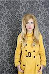 fashion retro blond woman yellow gabardine coat dark wallpaper Stock Photo - Royalty-Free, Artist: lunamarina                    , Code: 400-04299787