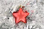 front view of red star, christmas decoration on silver tinsel Stock Photo - Royalty-Free, Artist: victoroancea                  , Code: 400-04302952