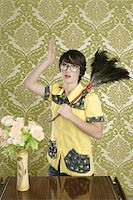 housewife nerd retro woman tired of home chores on vintage wallpaper Stock Photo - Royalty-Freenull, Code: 400-04304424