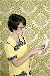 nerd housewife retro woman dial vintage wired phone 70s wallpaper Stock Photo - Royalty-Free, Artist: lunamarina                    , Code: 400-04304427
