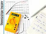 Yellow multimeter,  study the transistor theory paper and taking notes over a white background Stock Photo - Royalty-Free, Artist: madarakis                     , Code: 400-04304866