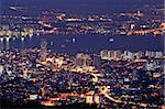 Cityscape of colorful night scene with river in Penang, Malaysia, Asia.