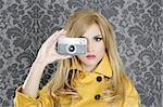 fashion photographer retro camera reporter woman vintage wallpaper yellow coat Stock Photo - Royalty-Free, Artist: lunamarina                    , Code: 400-04309359