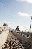 snow plow truck - Snowplow removing snow from intercity road from snow blizzard Stock Photo - Royalty-Freenull, Code: 400-04310006