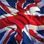Flag of the United Kingdom, fluttering in the breeze, backlit rising sun. Sewn from pieces of cloth, a very realistic detailed state flag with the texture of fabric fluttering in the breeze, backlit by the rising sun light Stock Photo - Royalty-Free, Artist: Antartis                      , Code: 400-04310083