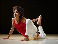 feet gymnast - portrait of young adult latin american female doing yoga exercise in gym. Horizontal shape, full length, side view, copy space Stock Photo - Royalty-Freenull, Code: 400-04318322