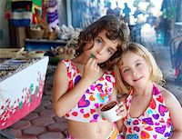 beautiful sisters  little girls eating chocolate ice cream in mexican market Stock Photo - Royalty-Freenull, Code: 400-04319298