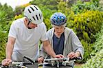 Mature couple mountain biking outside Stock Photo - Royalty-Free, Artist: 4774344sean                   , Code: 400-04326534