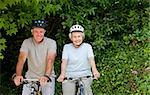 Senior couple mountain biking outside Stock Photo - Royalty-Free, Artist: 4774344sean                   , Code: 400-04326766