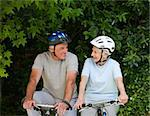 Senior couple mountain biking outside Stock Photo - Royalty-Free, Artist: 4774344sean                   , Code: 400-04326768