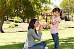 Joyful mother with her daughter in the park Stock Photo - Royalty-Free, Artist: 4774344sean                   , Code: 400-04327531