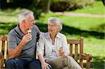 Senior couple eating an ice cream on a bench Stock Photo - Royalty-Free, Artist: 4774344sean                   , Code: 400-04327692