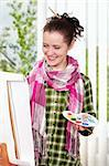 Beautiful girl with brushes near easel, painting on canvas. Stock Photo - Royalty-Free, Artist: fotostok_pdv                  , Code: 400-04329557