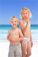 Brother and sister eating an ice cream Stock Photo - Royalty-Freenull, Code: 400-04331365