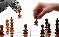 human playing chess with a machine Stock Photo - Royalty-Freenull, Code: 400-04332154