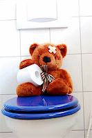 toy teddy bear with paper in the bathroom on toilet Stock Photo - Royalty-Freenull, Code: 400-04333961