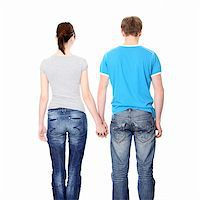 Young couple from behind, holding hands Stock Photo - Royalty-Freenull, Code: 400-04335020