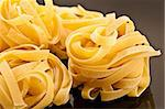 Italian raw pasta on a black plate Stock Photo - Royalty-Free, Artist: lindom                        , Code: 400-04335134