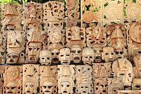 Mayan wood mask rows Mexico handcraft faces indian culture Stock Photo - Royalty-Freenull, Code: 400-04337031