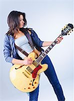 Young beautiful country music guitar girl smiling Stock Photo - Royalty-Freenull, Code: 400-04339383
