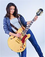 Young beautiful country music guitar girl smiling Stock Photo - Royalty-Freenull, Code: 400-04339384