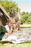 Happy family camping in the park Stock Photo - Royalty-Free, Artist: 4774344sean                   , Code: 400-04339501