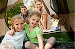 Happy family camping in the park Stock Photo - Royalty-Free, Artist: 4774344sean                   , Code: 400-04339502