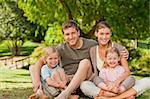 Lovely family in the park Stock Photo - Royalty-Free, Artist: 4774344sean                   , Code: 400-04339508