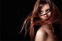 A pretty young girl with flowing hair Stock Photo - Royalty-Freenull, Code: 400-04340960