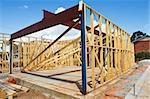 New residential construction home framing against a blue sky Stock Photo - Royalty-Free, Artist: LevKr                         , Code: 400-04341893