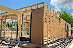 New residential construction home framing against a blue sky Stock Photo - Royalty-Free, Artist: LevKr                         , Code: 400-04341894