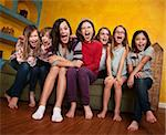 Group of happy barefoot girlfriends scream out Stock Photo - Royalty-Free, Artist: creatista                     , Code: 400-04342807